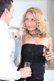 Flirting. Young executives flirting at a party Royalty Free Stock Image