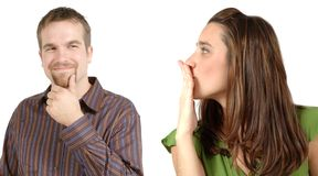 Flirting. Man looks at woman with a flirting grin and woman starts to blow him a kiss Stock Photo