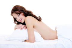 Flirting beautiful  woman with a sexy bare body Stock Photos