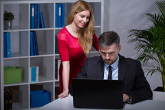 Flirting with boss royalty free stock photography