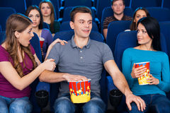 Flirting at the cinema. Stock Photography