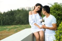 Flirting. Copy-spaced image of a young couple flirting on the balcony of the apartment Royalty Free Stock Photo