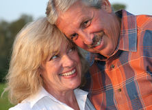 Flirting Couple. A good-looking mature couple flirting with eachother Stock Image