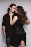 Flirting couple. Portrait of young flirting couple in casual clothing Stock Photos