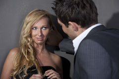 Flirting couple. Man flirting with a women standing at the wall Royalty Free Stock Photo