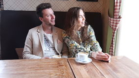 Flirting couple in cafe stock video footage