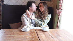 Flirting couple in cafe stock footage
