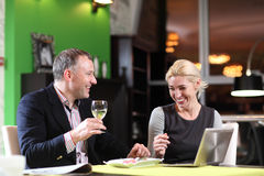 Flirting couple in cafe using digital tablet Royalty Free Stock Images