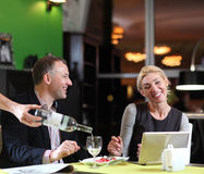 Flirting couple in cafe using digital tablet Stock Photos