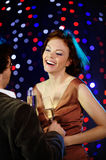 Flirting couple in the club. Vertical image of flirting couple Stock Photography