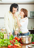 Flirting couple in home kitchen Stock Photo