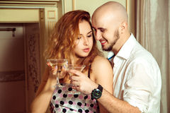Flirting couple with martini at home party Royalty Free Stock Photos