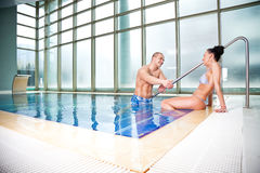 Flirting couple swimming pool Stock Photo
