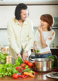 Flirting couple  with vegetables in  kitchen Royalty Free Stock Photography
