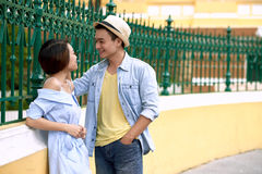 Flirting couple. Young cheerful Asian couple in love flirting outdoors Stock Photography