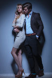 Flirting fashion couple standing embraced Stock Images