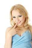 Flirting girl. Young flirting woman isolated over white background Royalty Free Stock Image