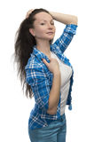 Flirting girl in blue jeans Royalty Free Stock Photography