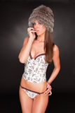 Flirting girl in furry hat and lingerie Royalty Free Stock Images
