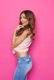 Flirting Girl On Pink Background Royalty Free Stock Photos