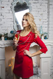 Flirting  Girl in red party dress with champagne Royalty Free Stock Photo