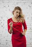 Flirting  Girl in red party dress Royalty Free Stock Images