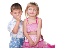 Flirting girl and thoughtful boy Royalty Free Stock Images