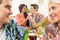 Flirting At House Party Stock Image