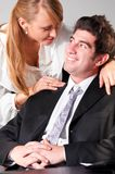Flirting at office Royalty Free Stock Images