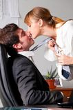 Flirting at office Stock Images