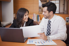 Flirting at the office Royalty Free Stock Image