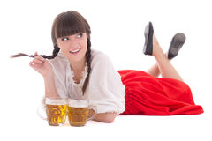 Flirting oktoberfest girl with cups of beer Stock Images