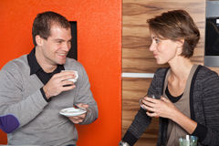 Flirting over coffee. Cute young couple having fun over a cup of coffee and tea Royalty Free Stock Image