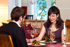 Flirting Over A Romantic Dinner Stock Photography