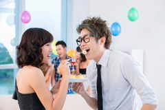 Flirting at party Stock Photo
