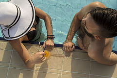 Flirting by the pool Stock Image