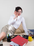 Flirting secretary in the office Royalty Free Stock Images
