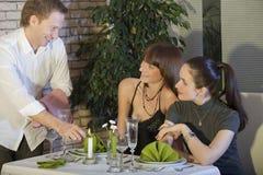 Flirting with waiter royalty free stock photo