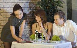 Flirting with waitress Royalty Free Stock Image
