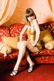 Flirting woman in golden dress royalty free stock image