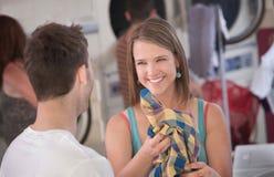 Flirting Woman in Laundromat Stock Photos