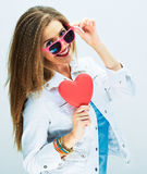 Flirting woman with long hair hold red heart Stock Photos