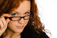 Flirting woman looking over her glasses Stock Photos