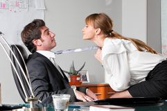 Flirting at work Stock Images