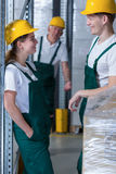Flirting in work. Young handsome warehouseman flirting with his colleague in work Royalty Free Stock Photo