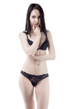 Flirting young woman in lingerie Royalty Free Stock Image