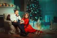 She flirts with man near a Christmas tree. Stock Photography
