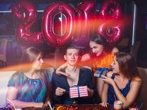 Flirty females at New 2018 Year party. Attention for macho man, Christmas gifts for young male. Romantic mood at celebration, seduction concept stock images