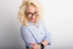 Flirty and funny woman looking over her glasses Stock Photos