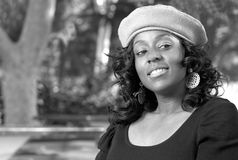 Flirty girl. Portrait of Flirty African-American 25 years old in the park Royalty Free Stock Images